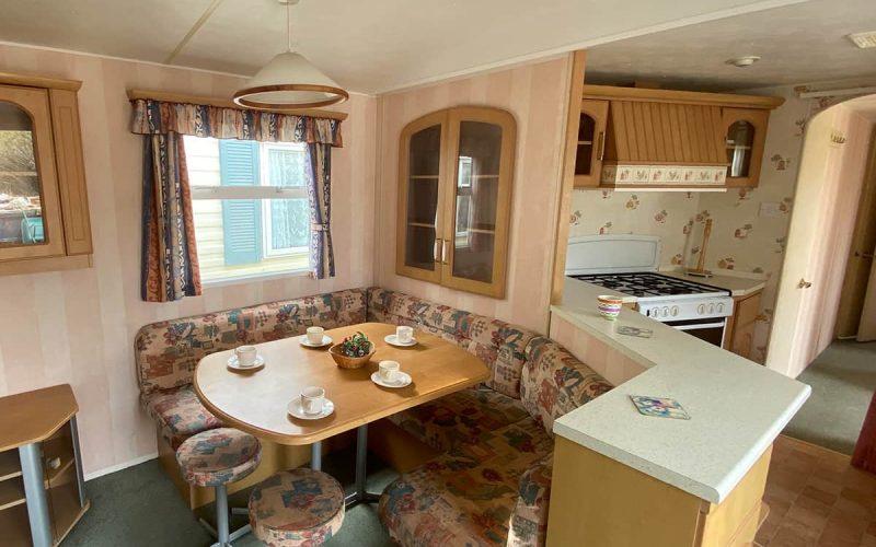 Comedor y cocina del modelo Atlas Florida 3 habitaciones